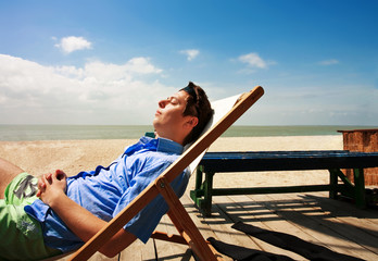 A young guy relaxing on the beach