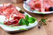 Close up of coppa with fresh herbs