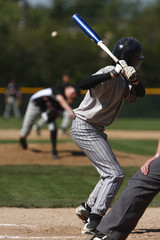 batter about to hit a pitch during a baseball game