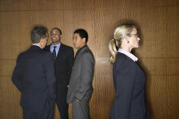 Businesswoman Walking by Businessmen