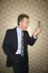 Businessman Yelling at Cell Phone