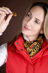 A mid adult woman looking at an acorn
