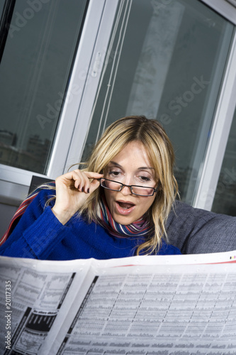 woman reading the paper