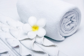 White  towel and yellow white tropical flower