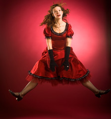 Women in red dress jumping