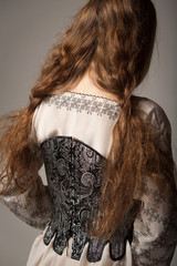 Woman in medieval corset and shirt