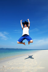 Single man made a powerful high jump at the beach