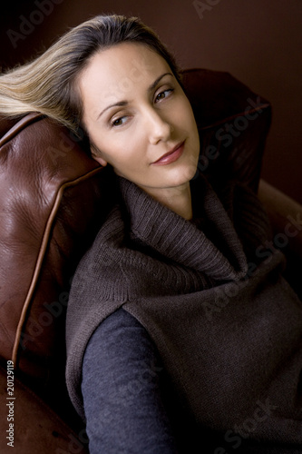 Portrait of a mid adult woman resting in an armchair