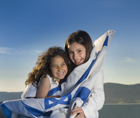 two girls with the Israeli flag