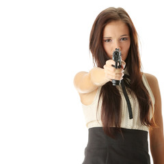 Young woman with hand gun
