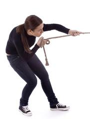 young long hair girl pulling grey rope, tug-of-war