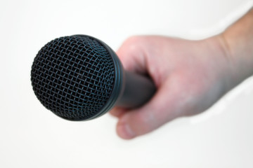 Hand with a microphone