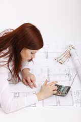 lying woman with house construction plan and calculator
