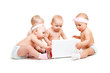 Babies working at laptop