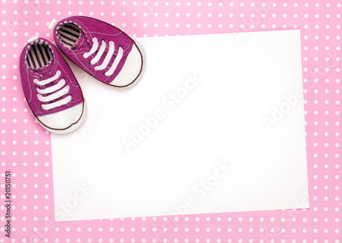Blank card with pink baby shoes
