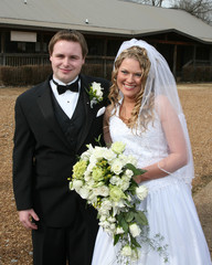 Bride and groom standing outside after the wedding