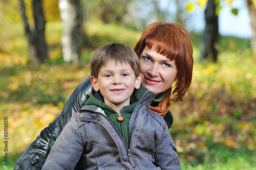 Beautiful happy mother and son for a walk in the park