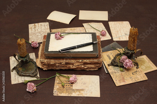 Vintage background with books, postcards and photo