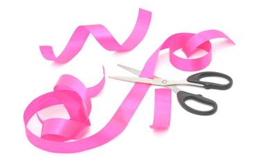 Scissors cutting a tape.