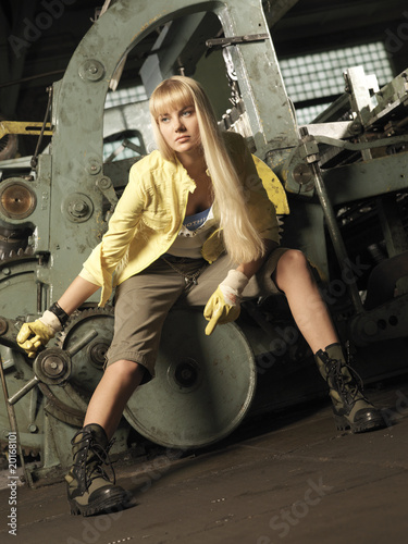 The girl against the machine tool