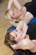 Two Beautiful Young Woman Aerobic Exercising At A Gym