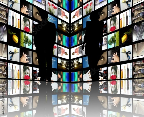 Journalists silhouettes with TV screens