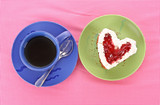 Cake heart and cup of tea on the table