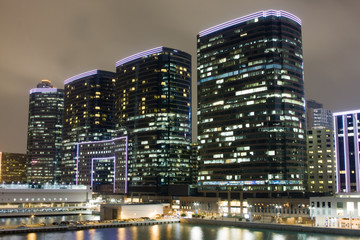 Hong Kong at night with highrise buildings.