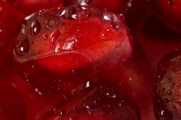 background of a red juicy ripe pomegranate fruit seeds