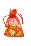 Chinese new year gold ingots and coins in red decorative sachet poster