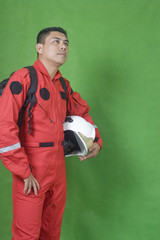 Portrait of man firefighter isolated on green