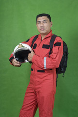 rescue firefighter holding safety helmet isolated on green
