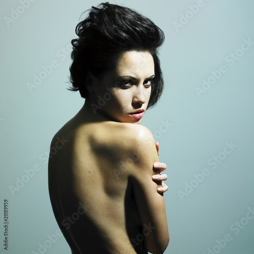 Nude sensual woman with predatory sight