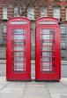 A pair of typical red phone booths in London