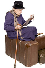 The old lady sits on a suitcase