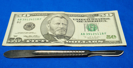 scalpel with money