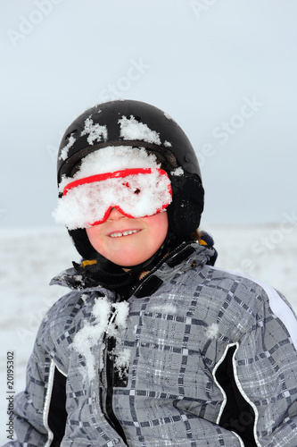 ittle boy with snowboard hard-hat