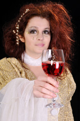 Young  girl with glass of wine selective focus on glass