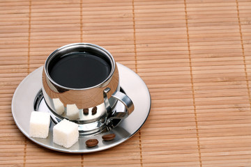 Cup of coffee on mat