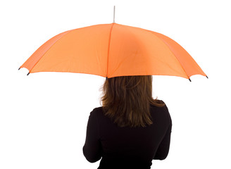 standing backwards young woman with orange umbrella