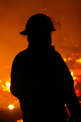 Silhouette of a fire fighter