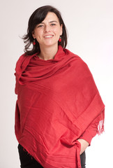 Smiling brunette in a red shawl