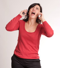 Stressed brunette talking with two phones