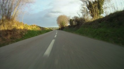 Fast drive along country road