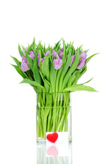 Bouquet of tulips in the vase and greeting card