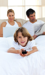 Joyful child holding a remote