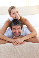 Enamoured couple lying on the bed
