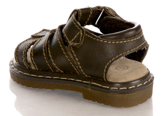 leather infant or baby sandal with reflection on white