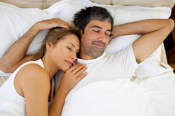 Positive couple sleeping