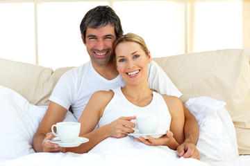 Attractive woman and her boyfriend drinking coffee